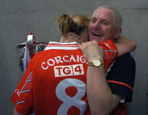 Cork coach Eamonn Ryan hugging team captain Juliet Murphy with the cup after defeating Galway in 2005. Picture: Denis Minihane.