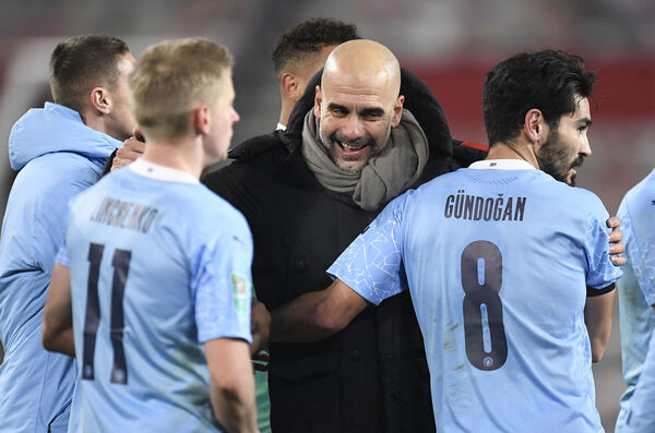 Manchester City manager Pep Guardiola celebrates with his players. Picture: Peter Powell/PA Wire