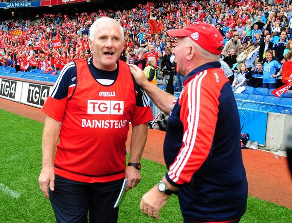 Cork manager Eamonn Ryan and selector Frank Honohan at the final whistle after defeating Dublin in 2014. Picture: Eddie O'Hare
