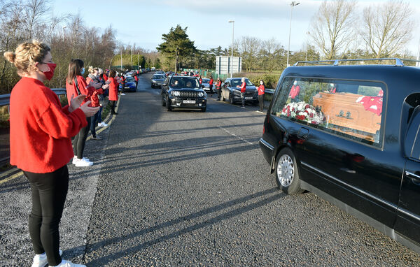 Valerie Mulcahy as the hearse passed at the UCC Farm. Picture: Eddie O'Hare