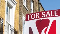 For Sale property agency sign posted outside English terraced houses in Poplar, East London
