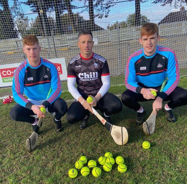 Ger Collins, Anthony Nash and Patrick Collins with the yellow Cummins All-Star sliotars that were used in the championship last winter. Picture: Kevin Cummins