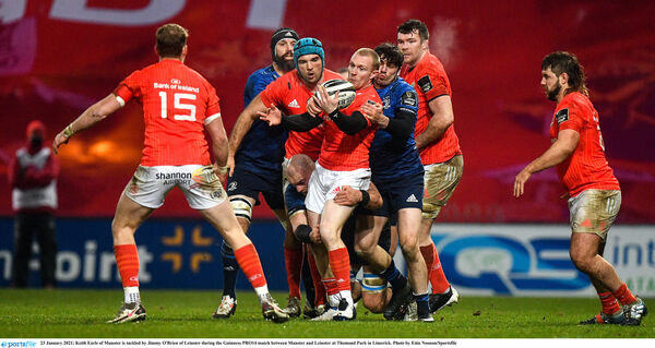 Keith Earls of Munster is tackled by Jimmy O'Brien of Leinster during the Guinness PRO14 match between Munster and Leinster at Thomond Park in Limerick. Photo by Eóin Noonan/Sportsfile