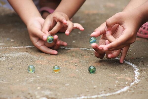 playing marbles stock shot