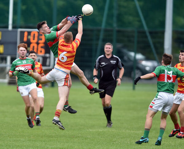 Clonakilty's Maurice Shanley goes high with Newcestown's Fionn Keane. Picture: Eddie O'Hare