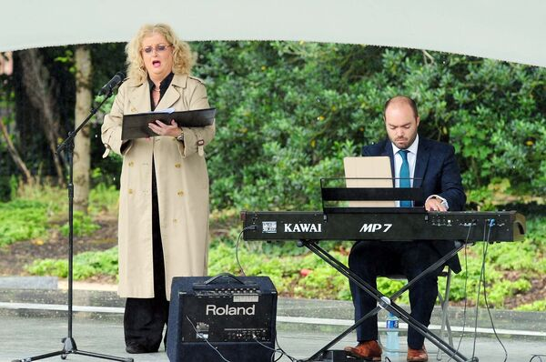 Cara singing with accompanist Eoin O'Callaghan during the National Day of Commemoration at Fitzgerald Park. Picture: Denis Minihane.