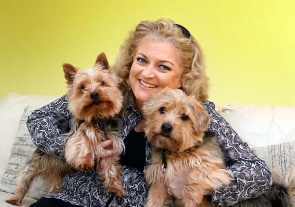 Cara having fun with her dogs Charley and Benny. Picture: Denis Scannell