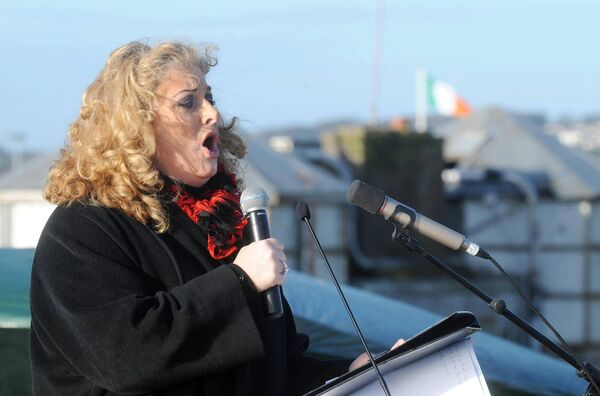 Cara O'Sullivan singing at a ceremony where members of 1 Brigade Artillery Regiment, Collins Barracks, Cork. Picture: Denis Minihane.