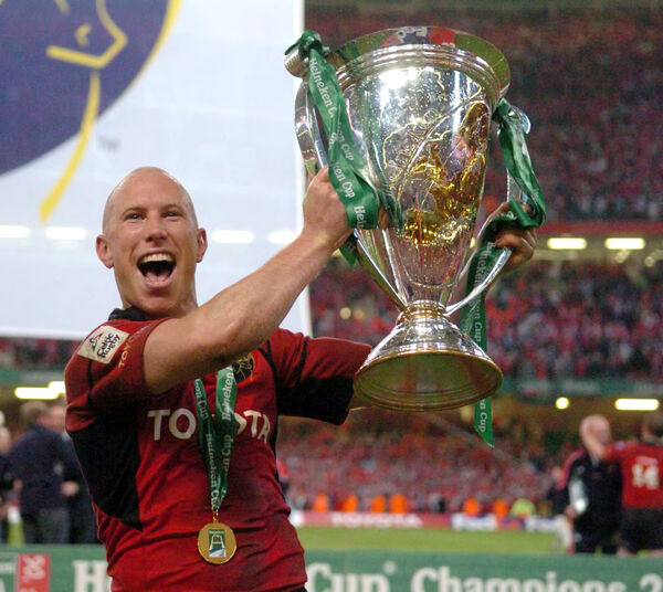 Peter Stringer raises the Heineken Cup. Picture: Eddie O'Hare