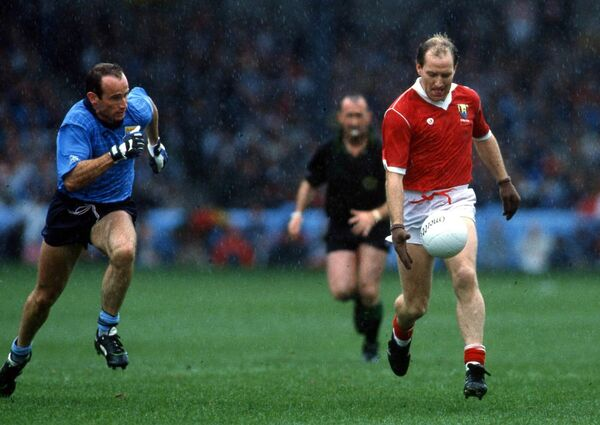 Dublin's Tommy Carr tracks Dave Barry of Cork in the 1989 All-Ireland football semi-final at Croke Park. Picture: INPHO