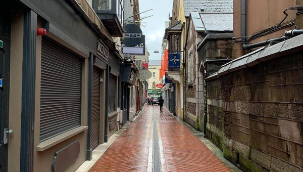 An empty Carey's Lane in early 2020 as businesses lining the street shut their doors under Government restrictions. Photo credit: Breda Graham.