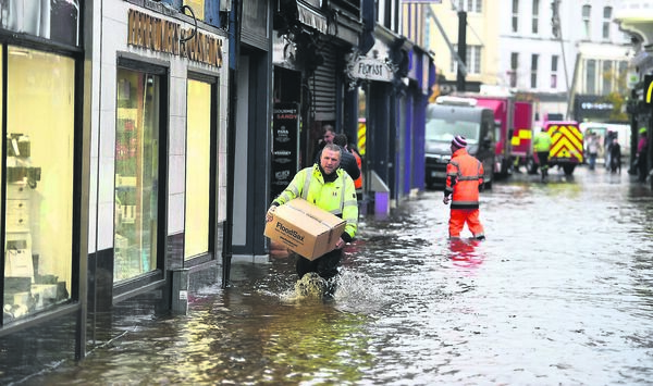 The civil defence working with shop owners on Winthrop Street in Cork after early morning flooding. Picture Dan Linehan