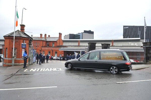Staff of Irish Rail applaud as the remains of Donncha Corcoran and the funeral cortege passes through Kent Station, Cork City on Saturday. Picture: Larry Cummins