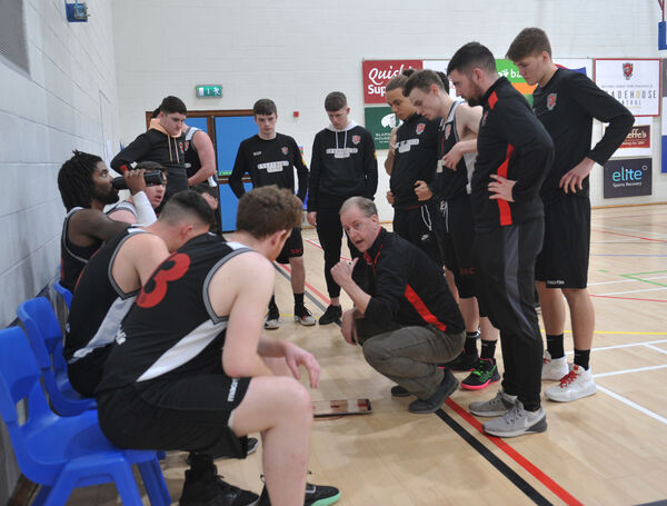 Coach Kieran O'Sullivan speaking to his Tradehouse Central Ballincollig team. Picture: Larry Cummins