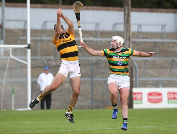 Patrick Horgan, Glen Rovers, closes in as Christopher Joyce, Na Piarsaigh, catches the sliotar in a club game. Picture: Jim Coughlan.