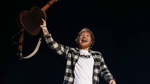 Up for grabs: Ed Sheeran makes rare appearance to announce guitar giveaway