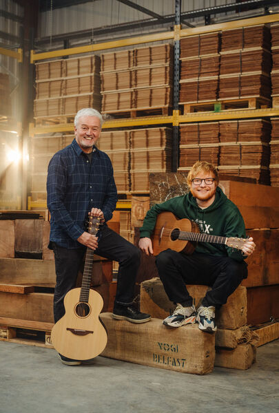 Ed Sheeran and George Lowden with one of the Sheeran by Lowden brand of guitars. The singer is giving away two signed guitars to fans. 	 Picture: Bradley Quinn/Lowden Guitars/PA Wire