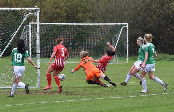 Saoirse Noonan, Cork City putting the ball past Treaty United keepr Maebh Ryan for her second goal during their Womens FAI cup semi-final at Curraheen, Cork. Picture Dan Linehan
