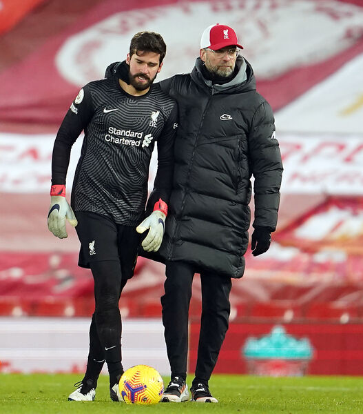 Liverpool goalkeeper Alisson and manager Jurgen Klopp. Picture: Jon Super/PA Wire.