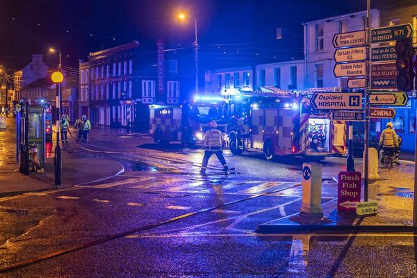Bantry town square flooded again this morning, due to high astronomical spring tides. Three units of Bantry Fire Brigade assisted Cork County Council workers to pump the flood waters away from properties, although a small number of premises were affected by flood water. Picture: Andy Gibson.