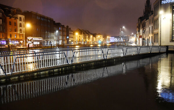 Trinity Bridge at high tide early on Saturday morning which resulted in minor flooding on the quays in Cork.