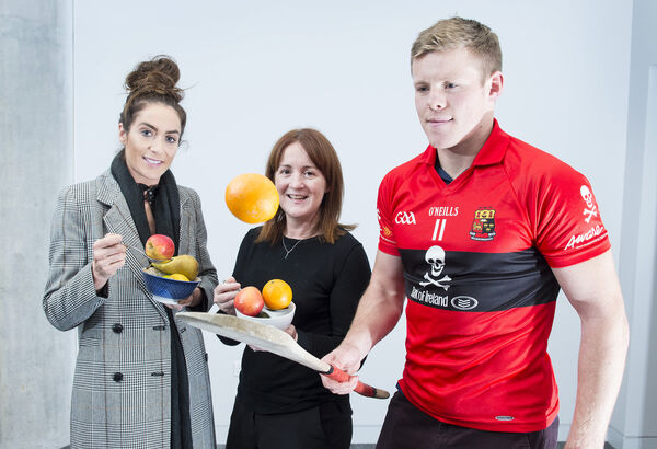 "Dr Sharon Madigan, centre,  Head of Performance Nutrition, Irish Institute of Sport, with basketball star Gráinne Dwyer and  Tom Devine, UCC and Waterford hurler at a ""Sporting A Better Diet"" event. Picture: Gerard McCarthy"