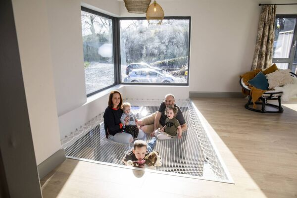 Rachel Hobbs pictured at home with husband Rob and their children Rocco, Indie and Forrest, on their net landing area. Picture: Clare Keogh