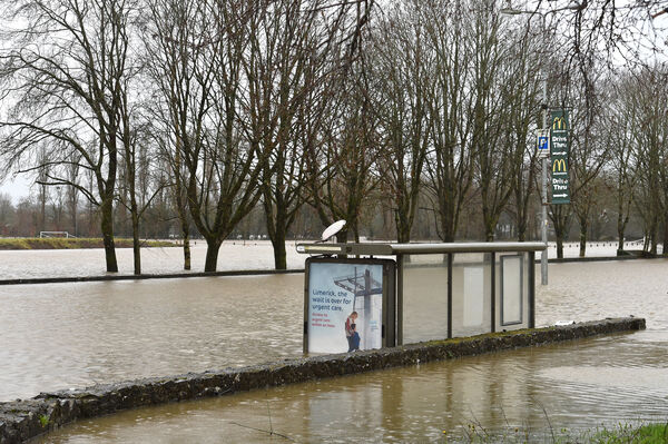 A partly submerged bus shelter in Mallow, Co Cork after the River Blackwater broke its banks. . Picture Dan Linehan