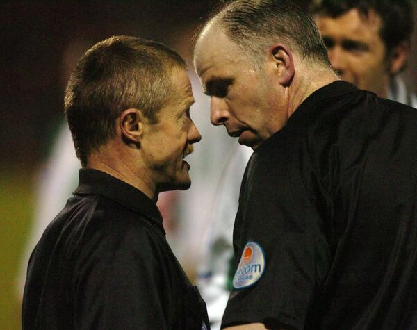 Referee Dave McKeon consults with assistant referee Eddie Foley at Turner's Cross. Picture: Eddie O'Hare