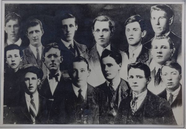 The fourteen members of the flying column who lost their lives as a result of the Battle of Clonmult. Front, from left: Donal Dennehy, Liam Ahern, David Desmond and Maurice Moore*. Middle, from left: James Glavin, John Joe Joyce, James Ahern and Michael Desmond. Back, from left: Richard Hegarty, Jeremiah Ahern, Christopher O'Sullivan, Joseph Morrissey, Michael Hallahan, and Patrick O'Sullivan*. *Captured at Clonmult and later executed after a trial by Military Court. This composite photograph was created in 1921, very soon after the battle, by John Hallahan of Midleton, brother of Michael.
