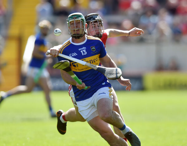 Tipperary's John O'Dwyer is tackled by Cork's Darragh Fitzgibbon. Picture: Eddie O'Hare