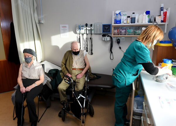 (right) Dr Nuala O'Connor gave the Covid-19 vaccine to 96 year-old Cathy Daly and her husband 94 year-old Tim Daly, pictured here in an examination room.