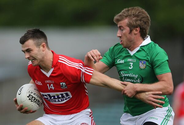 Limerick's Shane Gallager and Fiachra Lynch of Cork in 2013 junior action. Picture: INPHO/Cathal Noonan