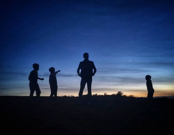 Photo submitted by Catharina Ward that shows her sons Shane (age 9), Michael (age 6), Jack (age 16), and Jamie Ward (age 4) stargazing.