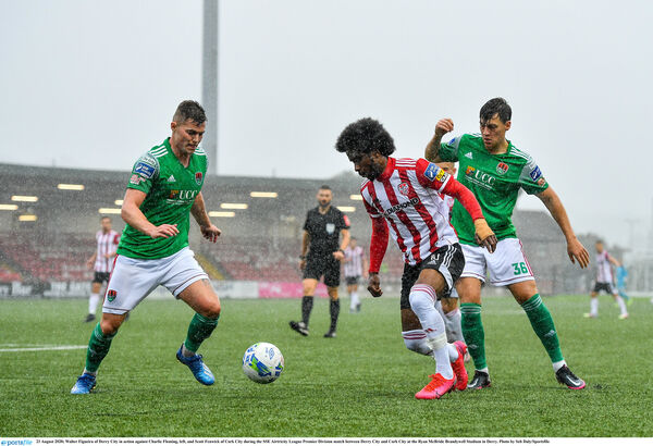 Walter Figueira of Derry City in action against Charlie Fleming, left, and Scott Fenwick of Cork City. Picture: Seb Daly/Sportsfile