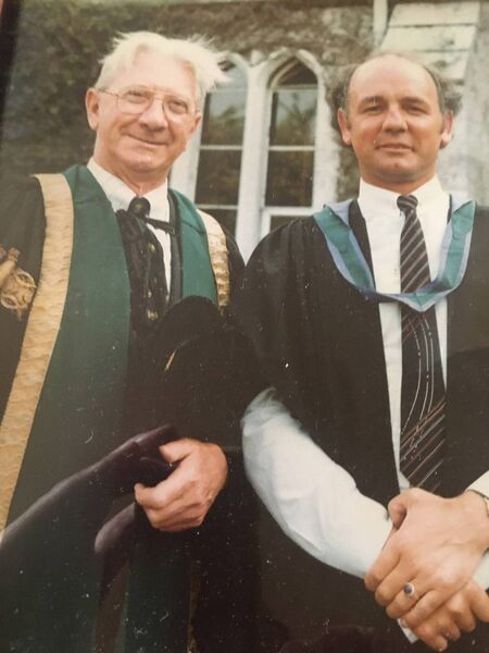 Tom Walsh, right, receiving his LLM from UCC in 1984.