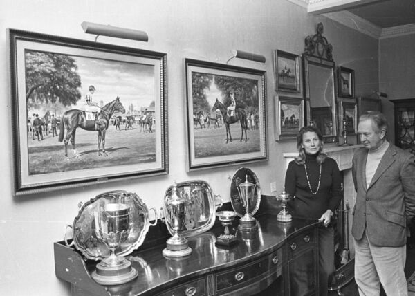 Vincent O'Brien and his wife at the stables at Ballydoyle, looking at his trophies.