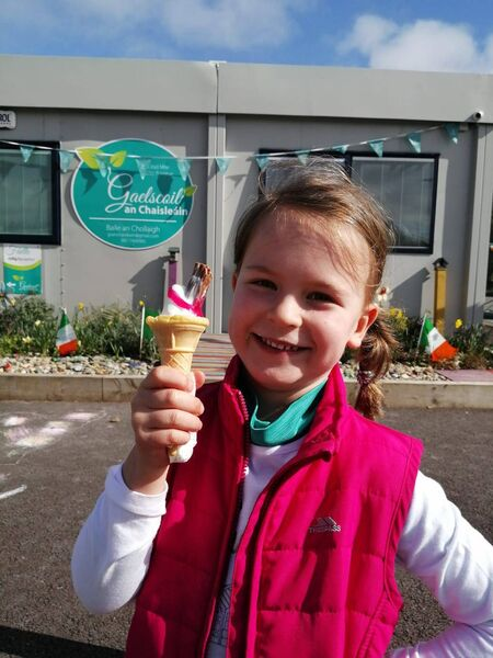 A pupil at Gaelscoil an Chaisleáin, Tanner Park, Ballincollig enjoying sunshine and ice cream at school ahead of St Patrick's Day.