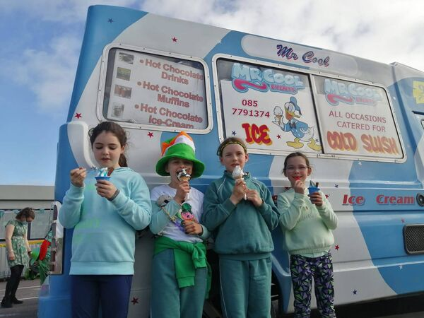 "The festivities included a colourful, creative parade,""cluichí agus rince Gaelach"" and the surprise arrival of Mr Cool's ice-cream van."
