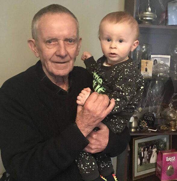 Coach John O'Leary with his great-grandson Charlie at their home recently.