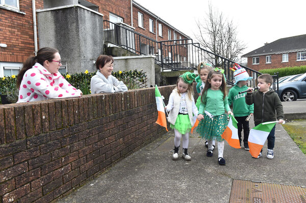 katie Bywater and Catherine Power watching the Pre-school children take part in their St. Patrick's Day parade near the Glenfields Community Childcare in Ballyvolane, Cork. Picture Dan Linehan
