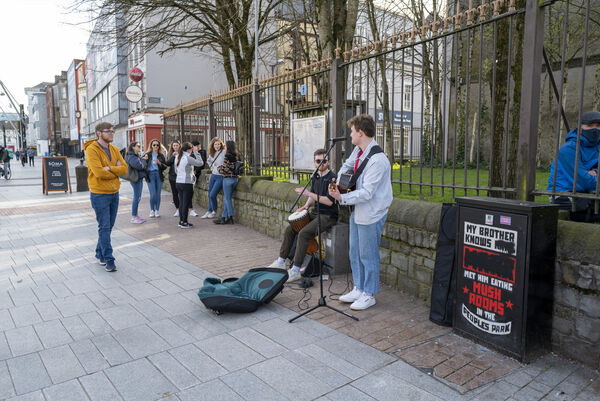 A busker playing music for people on St. Patrick's Day at the Grand Parade, Cork. Picture Dan Linehan