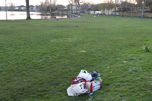 Empty bottles, cans, etc., placed in bags and a box at the Lough, Cork, after gardaí had to move on a crowd on St. Patrick's Day.