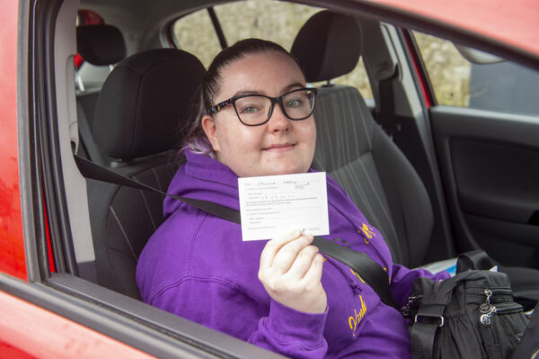 Leanne Kelly, Brothers of Charity with her vaccination card leaving the healthcare workers vaccination clinic which opened at Páirc Uí Chaoimh, Cork. Picture Dan Linehan