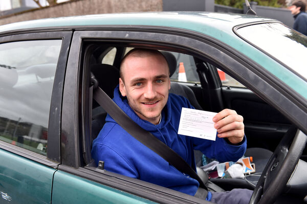 Lowell Ryan, Cope Foundation with his vaccination card leaving the healthcare workers vaccination clinic which opened at Páirc Uí Chaoimh, Cork. Picture Dan Linehan