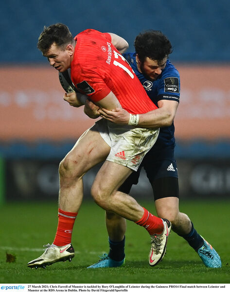 Chris Farrell of Munster is tackled by Rory O'Loughlin of Leinster. Picture: David Fitzgerald/Sportsfile