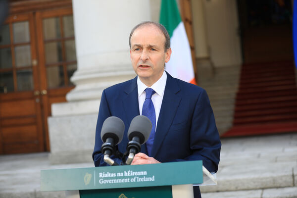 Handout photo issued by Julien Behal Photography of Taoiseach Micheál Martin during the announcement of the phased easing of restrictions over the next month.