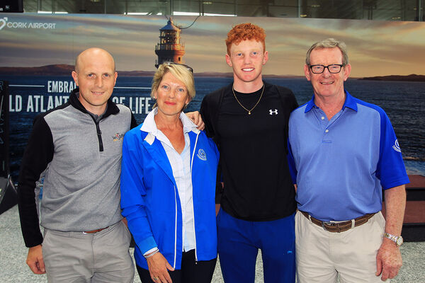 John Murphy pictured with his parents Carmel and Owen, and coach Ian Stafford on his return to Cork after winning the St Andrews Links Trophy in 2018. Picture: Niall O'Shea