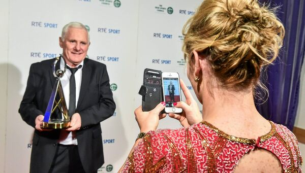Briege Corkery takes a picture of Eamon Ryan at the RTÉ Sports Awards 2014. Picture: David Maher/SPORTSFILE