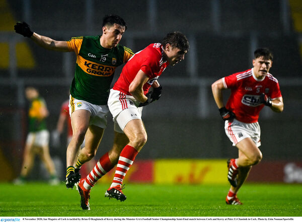 Ian Maguire of Cork is tackled by Brian Ó Beaglaíoch of Kerry. Picture: Eóin Noonan/Sportsfile